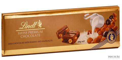 """Шоколад молочный """"Lindt. С цельным фундуком, миндалем и изюмом"""" (300 г) — фото, картинка"""