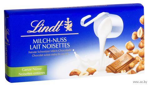 """Шоколад молочный """"Lindt. С цельным лесным орехом"""" (100 г) — фото, картинка"""